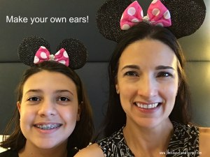 The Educational Tourist and girl wear matching Mickey Mouse ears with pink and white polka dotted bows on Disney cruise