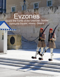 Evzones in khaki summer uniforms guarding tomb of unknown soldiers in Syntagma Square in Athens, Greece