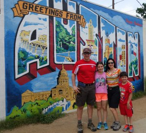 The Austin Postcard mural with family, What to do in Austin, Tx