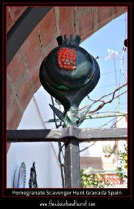pomegranate on garden fence