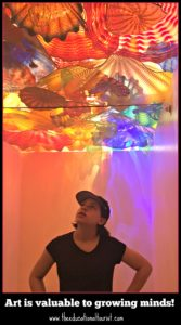 girl admiring Chihuly Glass