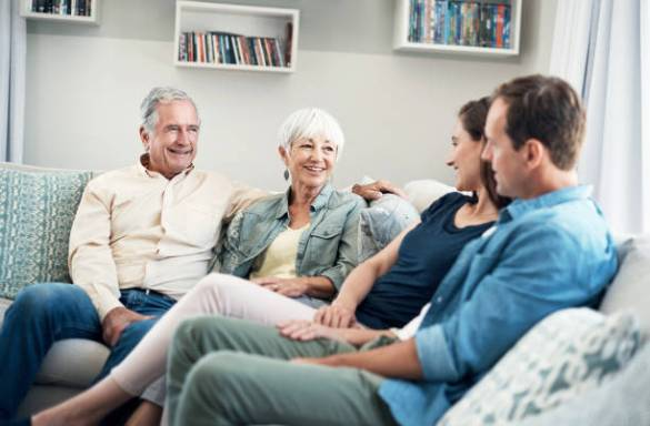 IMAGE: COURTESY. Shot of a young couple and their elderly parent spending some time together at home