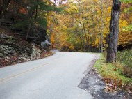 Caution: Curves and Color Ahead! This is my favorite road to drive on in the fall - Magnetic Road. The only place to stop is in the driveway where I am standing, and that's too bad. The color past that s-curve is unbelievable.