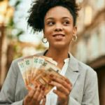 woman counting money to spend