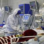 an-iranian-medic-treats-a-patient-infected-with-the-covid-19-virus-at-a-hospital-in-tehran