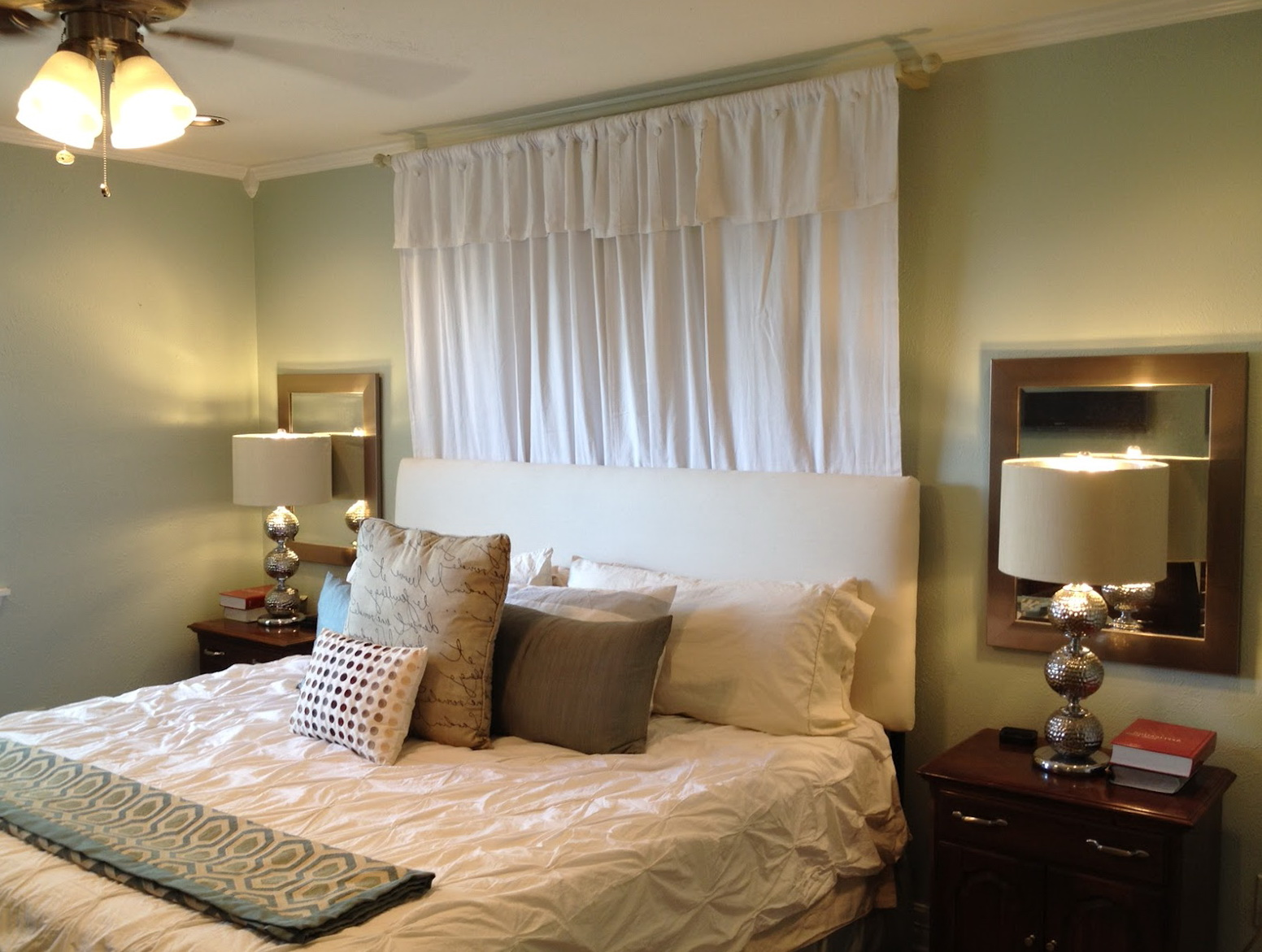 Bed With Curtains Behind