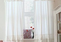 white ruffle curtain panel