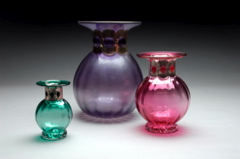 small coloured vases