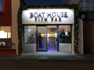 The Boat House Fish Bar used a long commercial luxury garland to frame their frontage for Christmas 2016