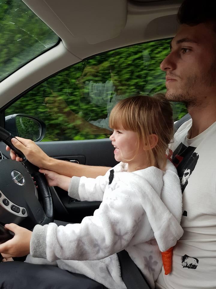 Shaniah sat on ryans lap driving the car