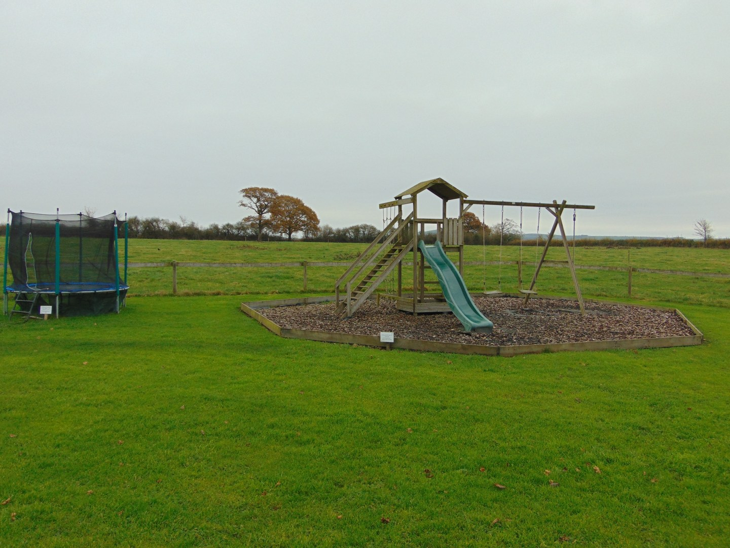 Childrens play area with trampoline and slide