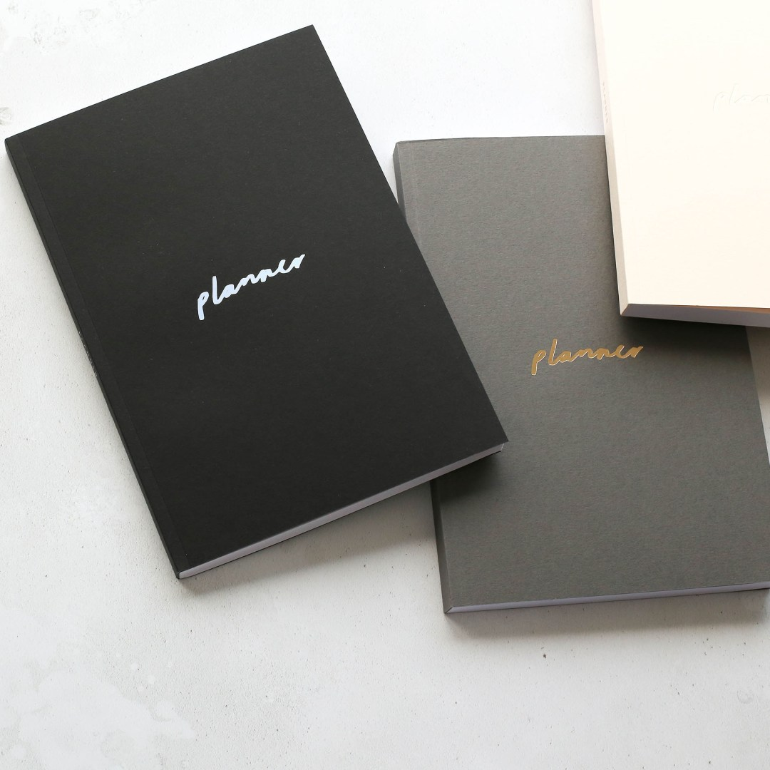 Black, grey and cream planners