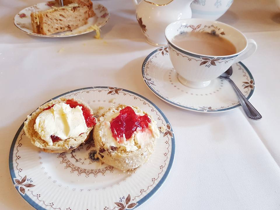 scones with cream and jam and a cup of tea