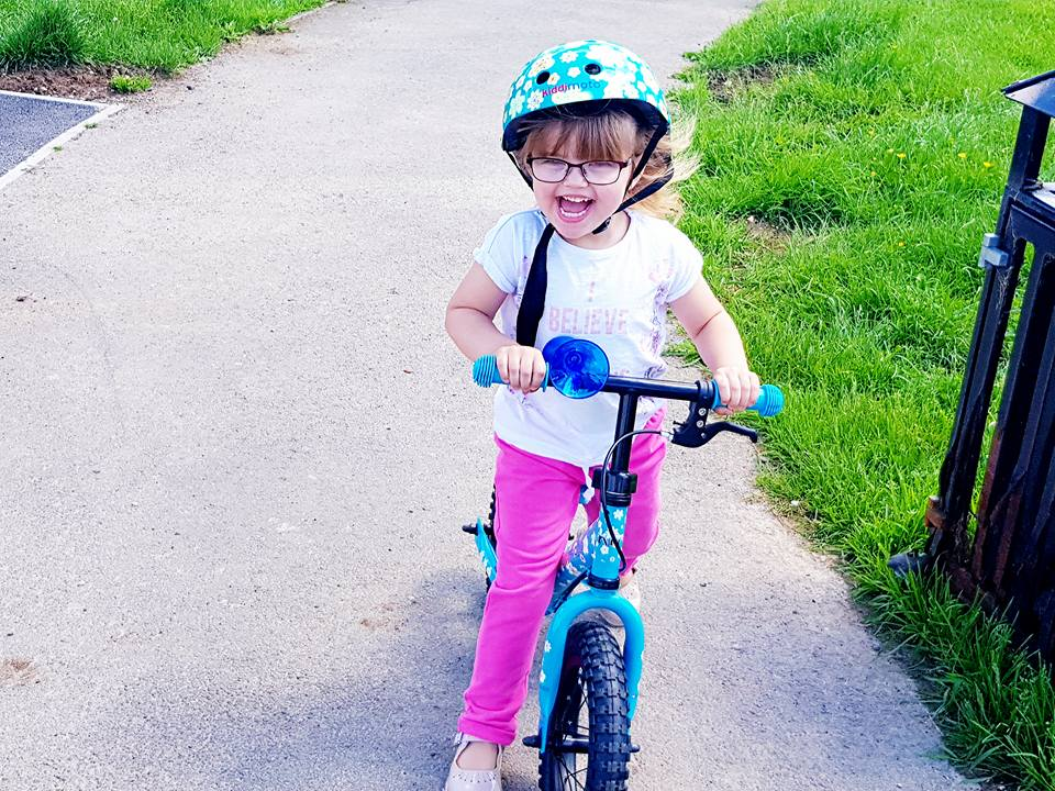 Shaniah on her bike with a big smile.