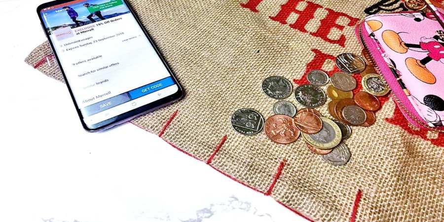 coins on a santa sac with phone