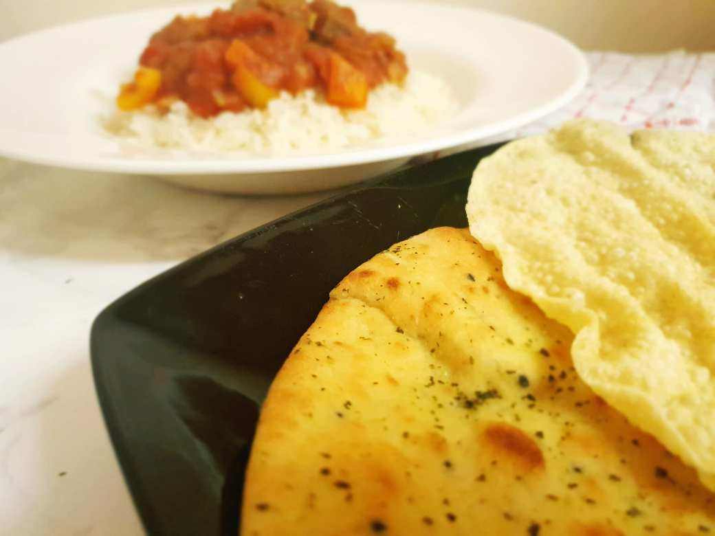 Beef curry with naan bread and popadoms