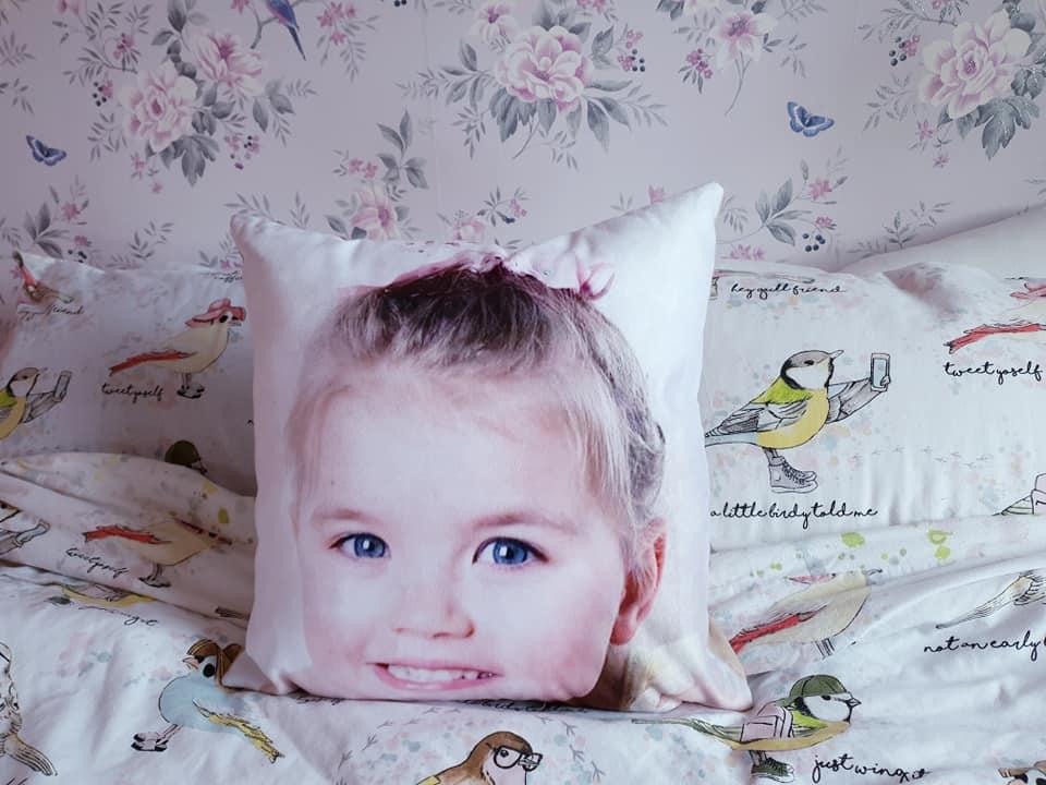 shaniah's face on a suede cushion