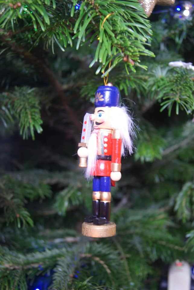 A Nutcracker hanging on our tree.