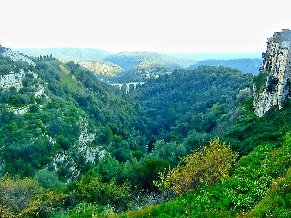 landscape in france with a bridge and mountain