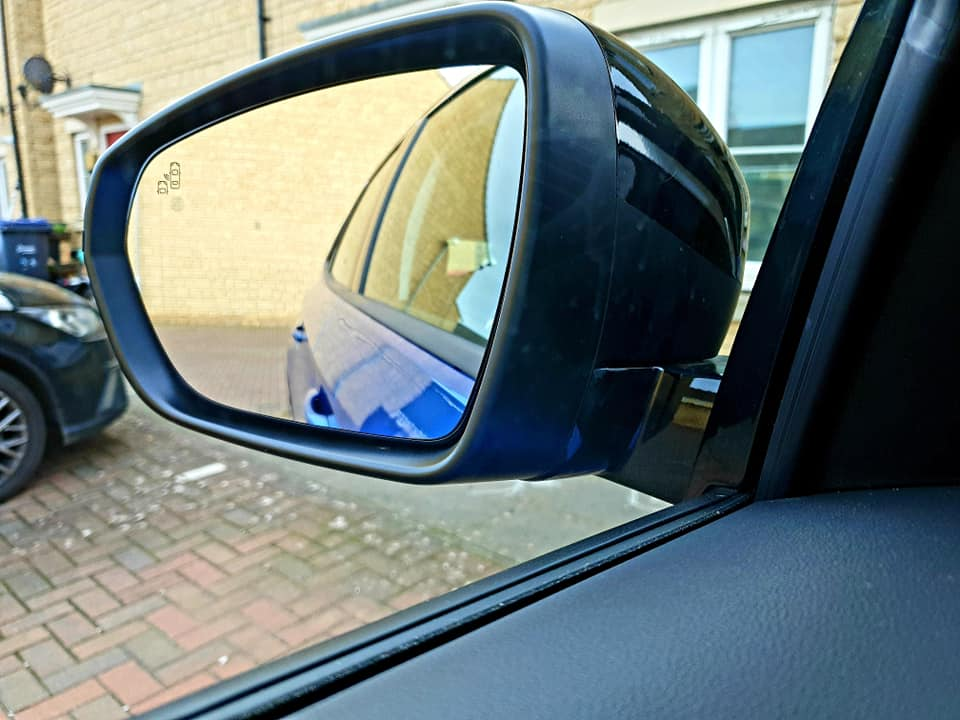 The Grandland wing mirror with built in safety light.