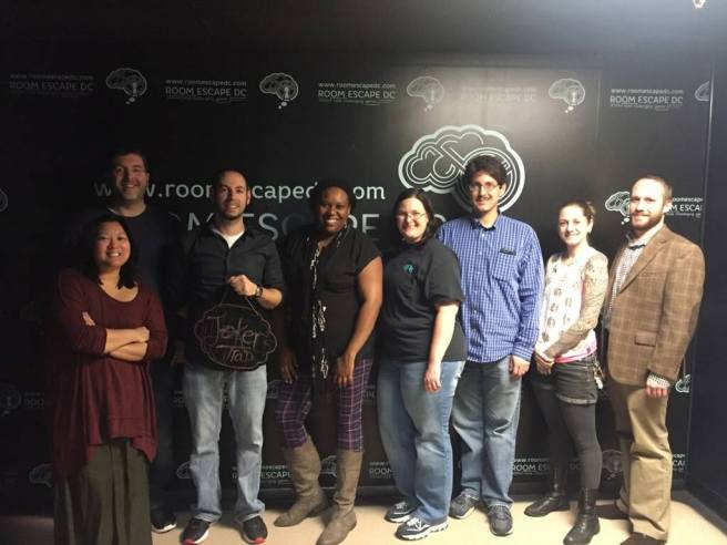 Team Disturbed Friends (Mike, Jason, Stephanie, Brittany, Corey, Tara and Eric) escaped the evil clutches of the Joker! Photo courtesy of Room Escape DC's Facebook page.