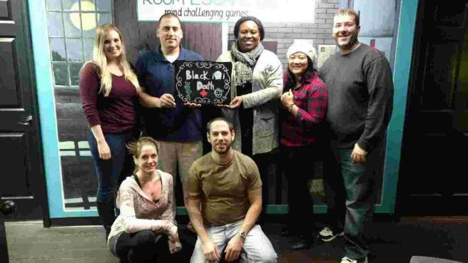 Team Disturbed Friends (Katheryn, Mark, Stephanie, Mike, Tara and Jason) solved the mystery of Molly's disappearance (we did both Horror Room and Black Death in the same night, so ignore the sign on this one). Photo courtesy of Room Escape DC's Facebook page.