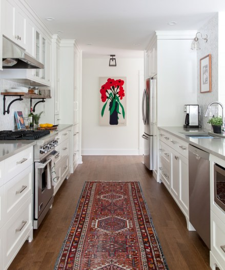 House Diaries Kitchen Renovation featuring a great Persian Rug in the kitchen galley