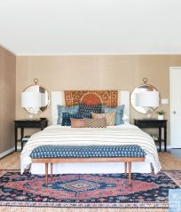 Suzani over Headboard via Amber Interiors