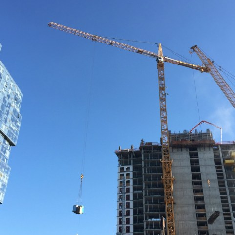 """[This pic] just makes me laugh every time. We see cranes and think of them as these work horse instruments that are tools to erect our new skyline, yet they perform very mundane functions as well. And yes, those are porta potties."" (Carl Leighty)"
