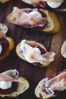 Prosciutto crostini's with goats cheese and cherry chipotle sauce