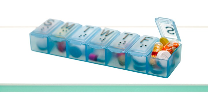 Pill dispenser filled with medications