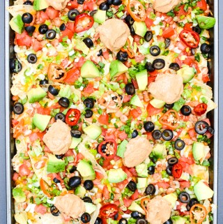 I've swapped some ingredients to lighten my 7-Layer Sheet Pan Nachos. This recipe is easy and versatile, so if you want to make changes, I say go for it! | theeverykitchen.com