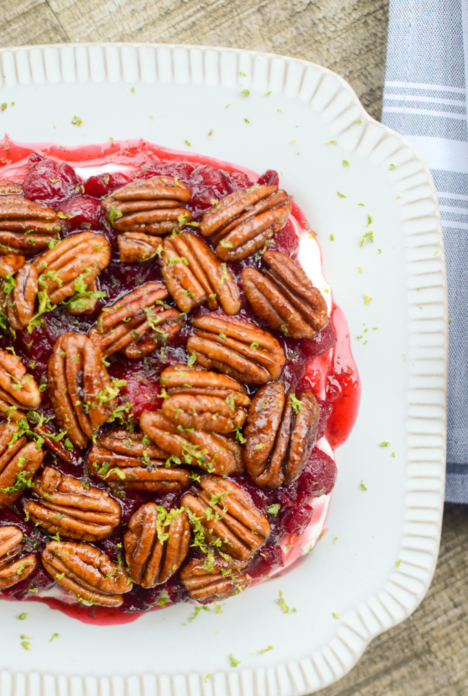 Cranberry Cream Cheese Dip with Candied Pecans is the perfect appetizer recipe for all your fall gatherings. It takes just 10 minutes to prep and makes enough to feed a crowd. #glutenfree #appetizer #holidayrecipe | theeverykitchen.com