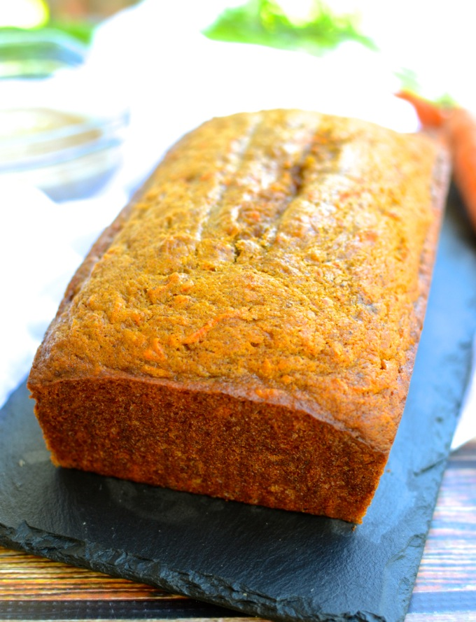 Carrot-Pumpkin Bread with Cider Glaze will make you dream of sitting on the porch with leaves falling all around and a cup of hot cider in your hand.   theeverykitchen.com