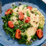 Pan-Poached Tilapia with Lemon Caper Sauce is a 25-minute foolproof recipe for any weeknight dinner. It's gluten free and sugar free too! | theeverykitchen.com