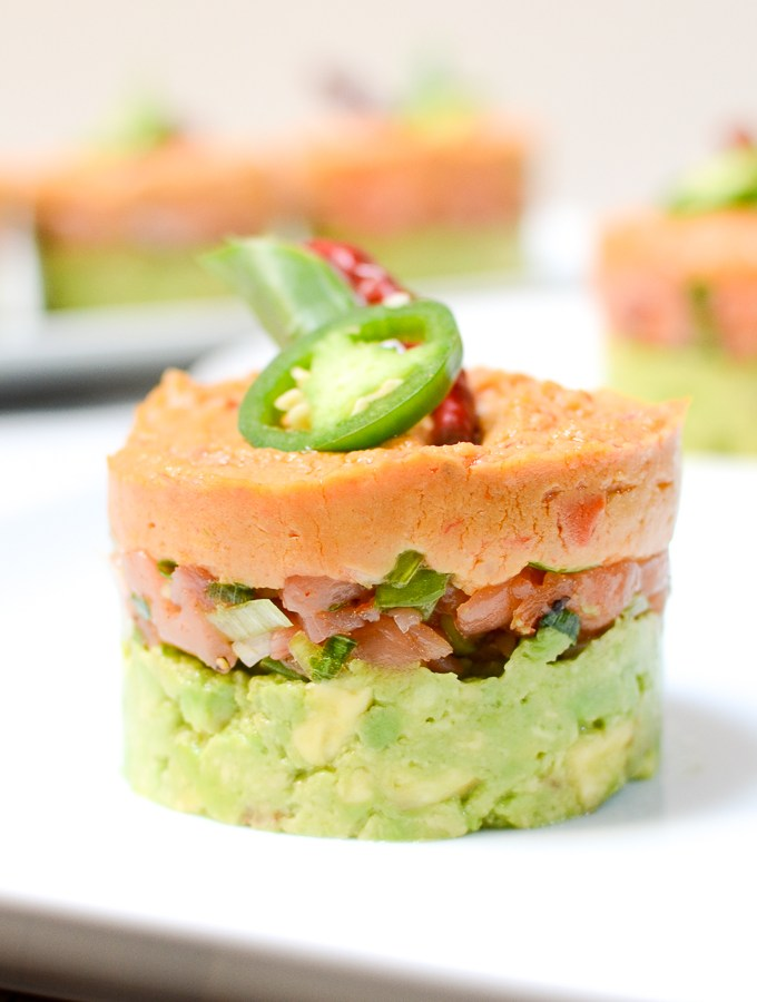 Spicy Salmon, Hummus, and Avocado Stacks are an easy show-stopping appetizer. This recipe is vegetarian, sugar free, and gluten free and the flavor is BOMB. #AD | theeverykitchen.com