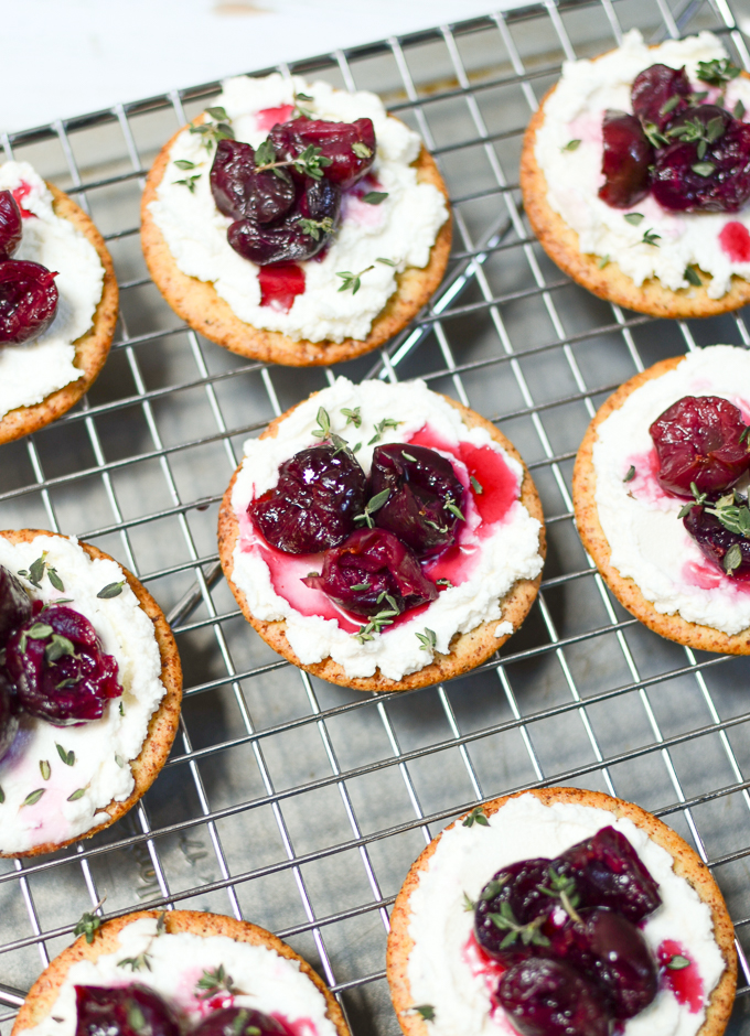 Roasted Cherry, Whipped Goat Cheese, & Thyme Hors d'Oeuvres are a can't-stop combo of juicy cherries, tangy goat cheese, and earthy thyme, atop a crispy cracker. | theeverykitchen.com