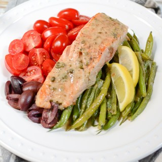 "Salmon Nicoise Salad with Dijon Caper Dressing tastes like a ""treat yourself"" meal, but it's gluten free, sugar free, low-carb, paleo-friendly, and deceptively easy to prepare. 