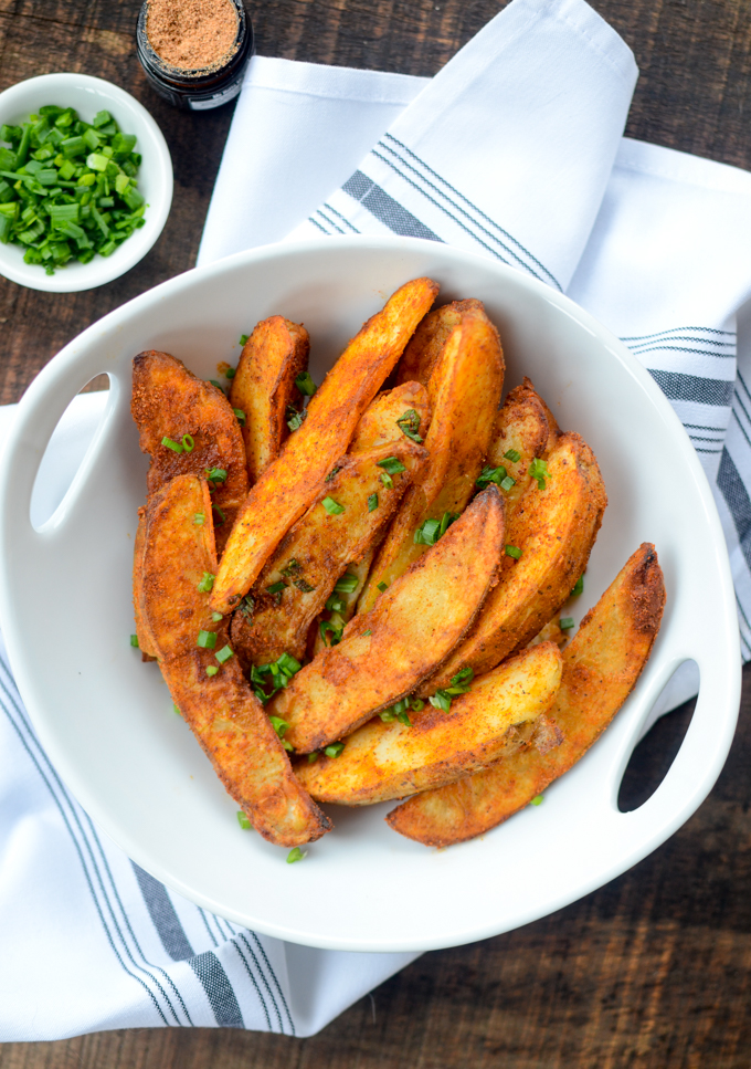 Air Fryer Spiced Potato Wedges are the perfect healthy alternative to French fries, with their crispy finish and golden-fried hue.  | theeverykitchen.com