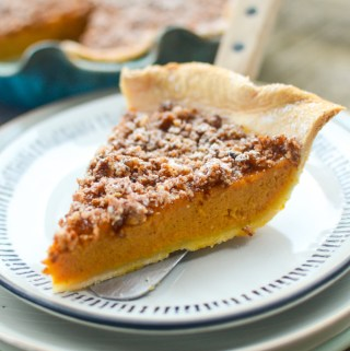 Rum Pumpkin Praline Pie is the perfect combination of light and boozy, sweet and salty. A store-bought crust makes this recipe practically effortless. #boozy #pie #dessert | theeverykitchen.com