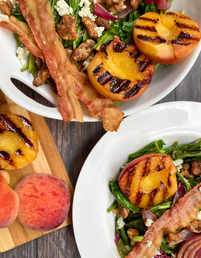 Wilted Spinach Salad with Grilled Peaches with warm, soft caramelized onions, tossed in this blue-cheesy infused balsamic vinaigrette. That combination just goes gangbusters with the salty, crispy bacon, the candied walnuts, and that juicy grilled peach.   theeverykitchen.com