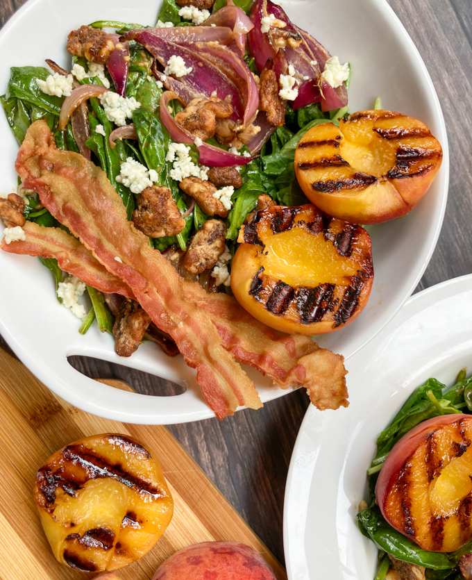 Wilted Spinach Salad with Grilled Peaches: You'll know you got it right when peach juice drips from the corner of your lips and onto your white shirt. In three places. On the first bite. I know from experience. | theeverykitchen.com