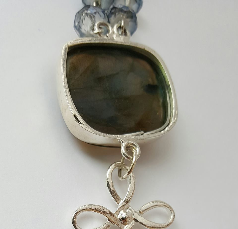 back of stone in silver setting - labradorite penant