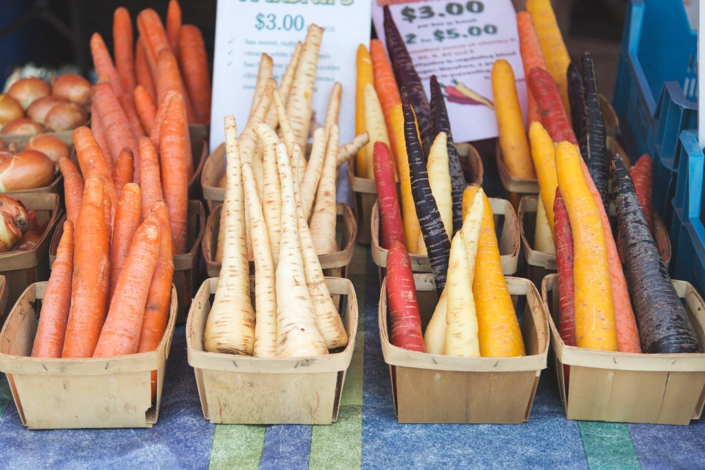 parsnips and carrots at the market