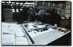 Armando looking over prints for the book release (Photo from The Path via Waybackmachine)