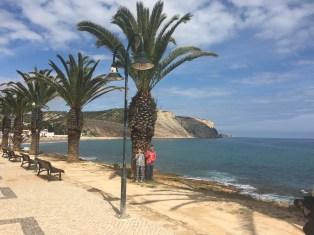 Walking along the boardwalk in Praia da Luz