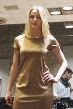 Grace T is startling divine in a metallic gold 90s minimal dress from HAWK & SPARROW