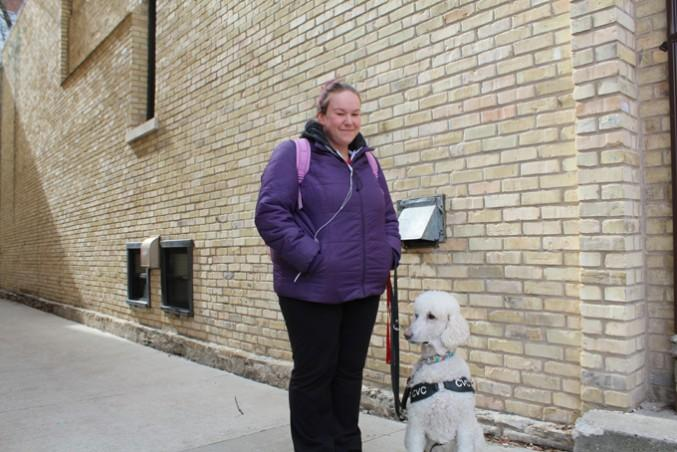 Michelle Woolfrey and her service dog Thompson. PHOTO: ANNIE ARNONE