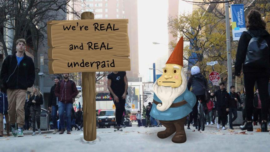 An elf stands on Gould Street next to a sign that reads: We're real and REAL underpaid!