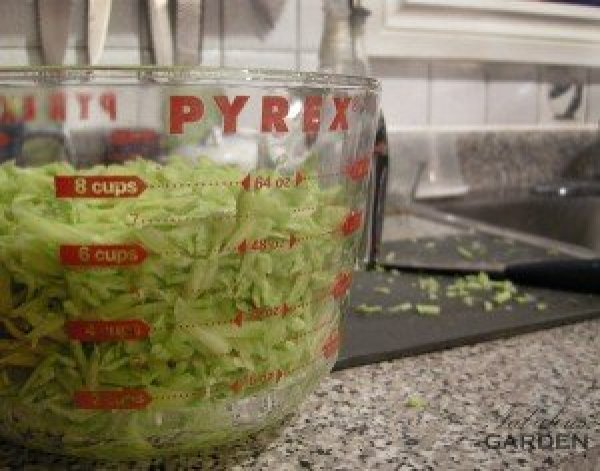 grated zucchini in glass meausring cup